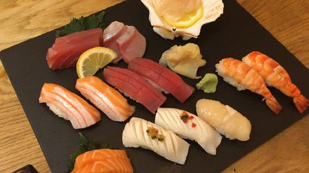 A sushi and sashimi selection at Hot Stone including salmon, tuna, hamachi and butterfish
