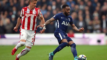 Stoke City's Moritz Bauer (left) and Tottenham Hotspur's Danny Rose battle for the ball (pic Nigel F
