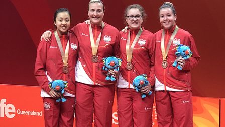 Tin-Tin Ho (left) helped England win bronze in the women's team table tennis at the 2018 Commonwealt