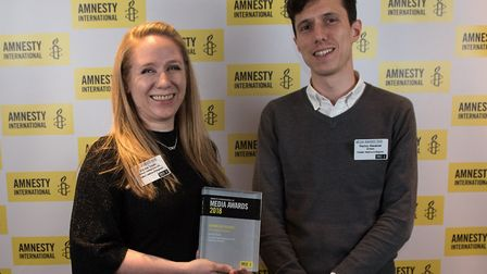 Investigations journalist Emma Youle and Gazette editor Ramzy Alwakeel with the Amnesty award for Em