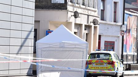 A police tent and tape on Morning Lane at the junction with Link Street after the fatal stabbing. Pi