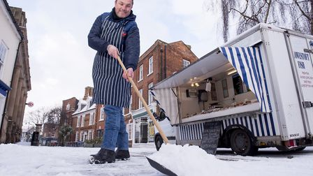 Matthew Wylds from Steves Seadish clears the snow from the pavement in Beccles.Picture: Nick Butcher