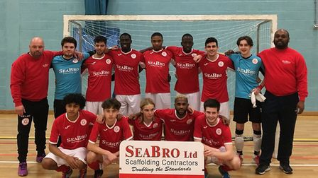 The Genesis Futsal team, which competes in the National Futsal Super League, face the camera with co