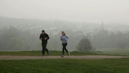 Joggers on Hampstead Heaths. PICTURE: YUI MOK/PA IMAGES
