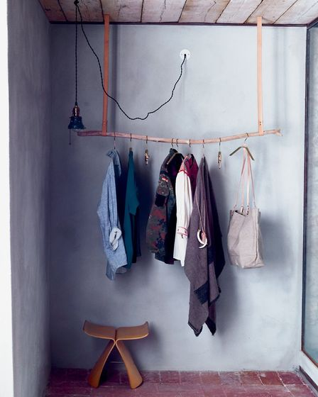 The rail can be used to hang outdoor coats