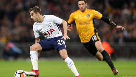 Tottenham Hotspur's Harry Winks and Newport County's Ben Tozer (right) battle for the ball during th