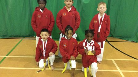Hackney's Olympic Karate Club youngsters face the camera