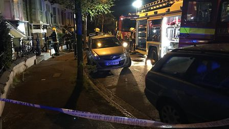 Police at the scene of the fire in Sydner Road. Picture: @MPSHackney