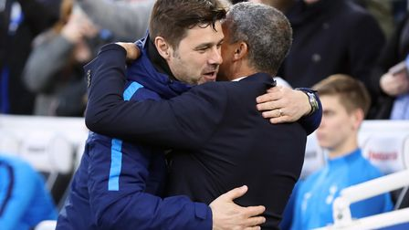 Tottenham Hotspur manager Mauricio Pochettino (left) embraces Brighton & Hove Albion manager Chris H