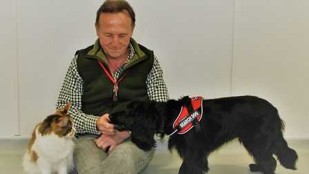 Colin Butcher and Molly have reunited over forty owners with their missing cats. Photo: The Pet Dete