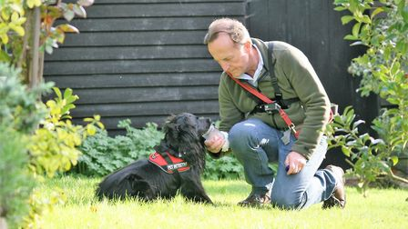 Retired police officer and pet detective, Colin Butcher, with his cat detection dog, Molly. Photo: T