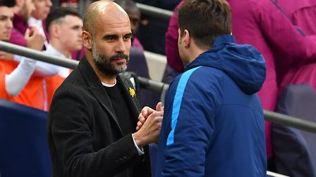 Manchester City manager Pep Guardiola (left) and Tottenham Hotspur manager Mauricio Pochettino shake
