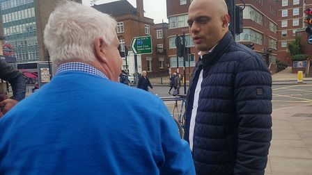 Sajid Javid speaks to a passer-by while being interviewed by the Ham& High in Finchley Road. Picture