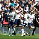 Tottenham Hotspur's Harry Kane celebrates scoring his side's first goal of the game with team-mates