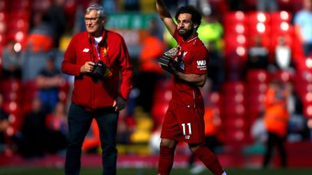 Liverpool's Mohamed Salah with the golden boot award after the final whistle in the Premier League m