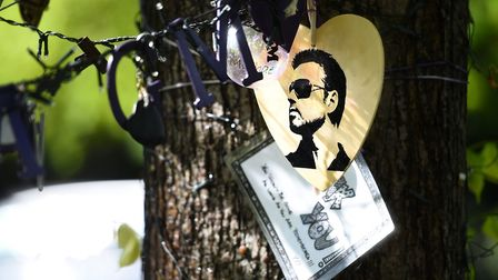 Tributes to George Michael outside his house in Highgate. His family recently asked fans to remove t
