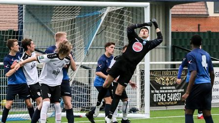Wingate & Finchley's under-23 goalkeeper Reuben Rabstein punches clear during the Champion of Champi