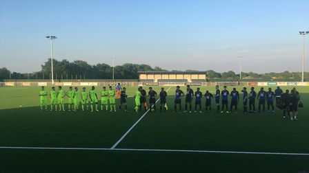 Wingate & Finchley and Hastings United players shake hands ahead of the Bostik Development League Cu