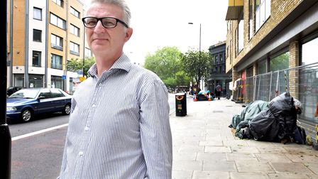 Jon Williams, director of Heathwatch Hackney on Mare Street with homeless people's tents on the pave