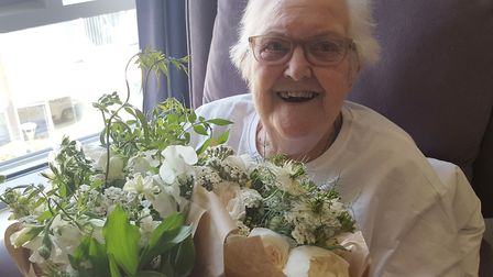 Pauline Clayton, 89, with her boquet of flowers. Pic: PA