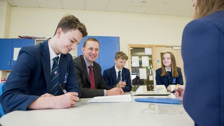 Pakefield High School headteacher Anthony Walker with key stage 4 students.Picture: Nick Butcher