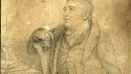 A Sotherby's technician shows off Lot 99, a portrait drawing of Samuel Taylor Coleridge, signed and