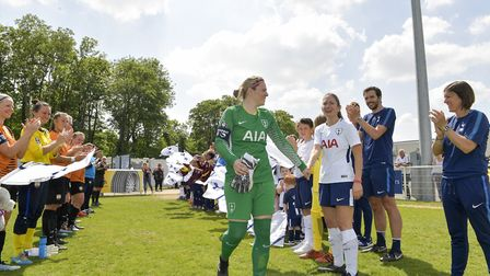 Toni-Anne Wayne is given a guard of honour by both Tottenham Hotspur Ladies and London Bees during t
