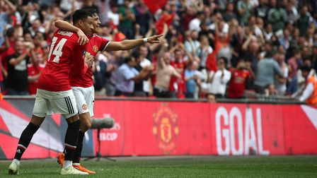 Manchester United's Alexis Sanchez (right) celebrates scoring his side's first goal of the game with