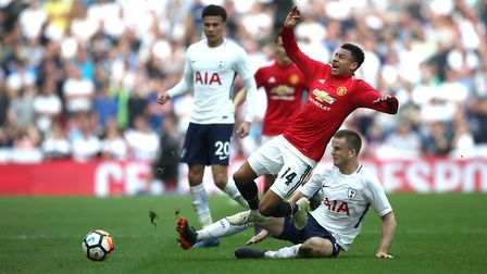 Manchester United's Jesse Lingard (second, right) battle for the ball with Tottenham Hotspur's Eric