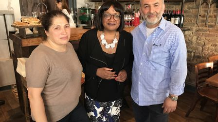 Sefika Erdal and Adil Kolcak with Diane Abbott, centre, at the opening of Acoustic in Stoke Newingto