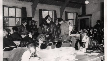 Lenny, right, and Jill Hargreaves, second right, writing letters to members advising them of the mov