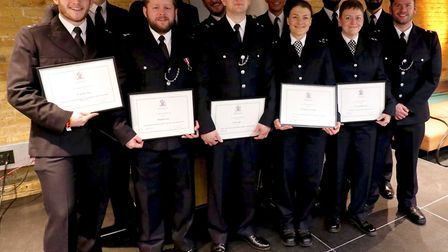 The team of officers who were commended for their work trying to save twin babies from being killed