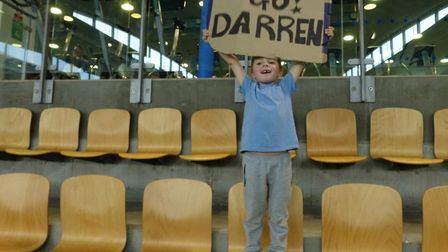 Darren's four-year-old son Jacob with the 'go Darren' sign. Picture: Darren Cainey