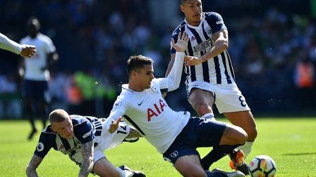 Tottenham Hotspur's Erik Lamela (centre) battles for the ball with West Bromwich Albion's James McCl