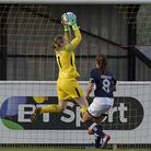 Tottenham Hotspur Ladies goalkeeper Toni-Anne Wayne catches a cross despite the close attention of a