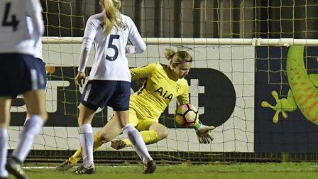 Tottenham Hotspur Ladies goalkeeper Toni-Anne Wayne saves a shot from a Millwall Lionesses opponent