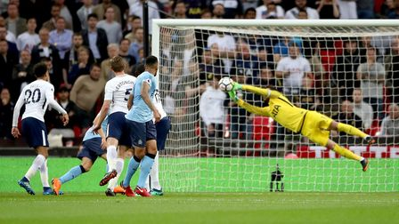 Tottenham Hotspur goalkeeper Hugo Lloris saves a header from Newcastle United's Jamaal Lascelles (ce