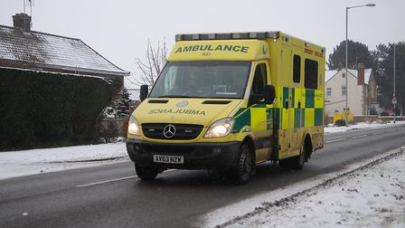 An ambulance driving along icy roads. Picture: Chris Bishop