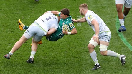 London Irish's Piet van Zyl is tackled by Saracens' Vincent Koch during the Aviva Premiership match