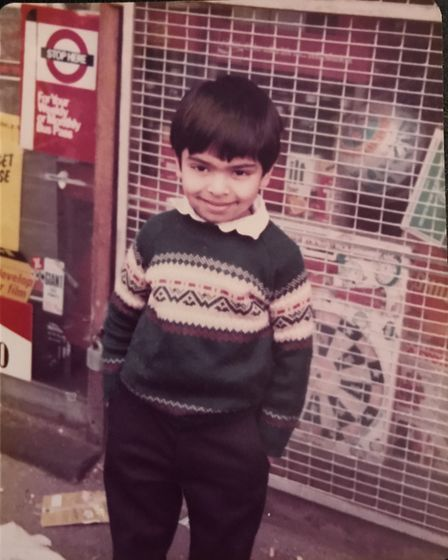 A young Avnish outside the shop.