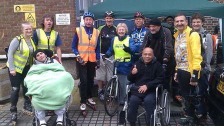 Assembling outside the hospice courtyard for Wheels and Wheelchairs' first group stroll in October 2