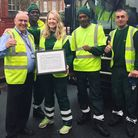 Catherine with Glen Witby (left) and his waste and recycling team. Picture: Hackney Council