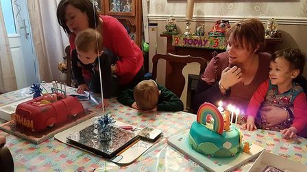 Cohen and Ethan enjoy birthday cake with parents Aimee and Kirstie. Photo: Aimee Messenger.