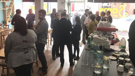 Business owners, members of the public and community groups gathered for the relaunch of Sams Coffee