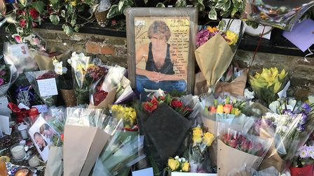 The shrine created by fans outside George Michael's home in The Grove is to be dismantled. Picture: