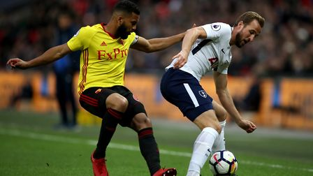Watford's Adrian Mariappa (left) and Tottenham Hotspur's Harry Kane battle for the ball during the P