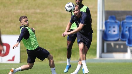 England's Harry Kane during the training session at St George's Park alongside Kieran Trippier (left