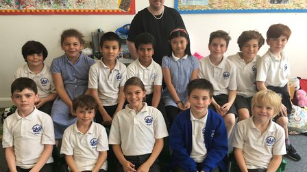 The Queensbridge Primary School chess team, with coach Lee Bullock (back). Picture: Lucy Hockings