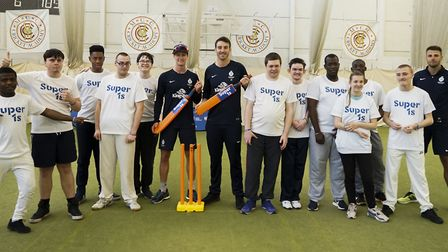 Middlesex players Toby Roland-Jones, Nick Gubbins, John Simpson and Tom Barber pose with youngsters
