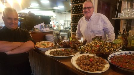 Owner of Osteria Ovada Paolo Cometa (right) with his chef Giovanni Bunocosta (left) and a table of a